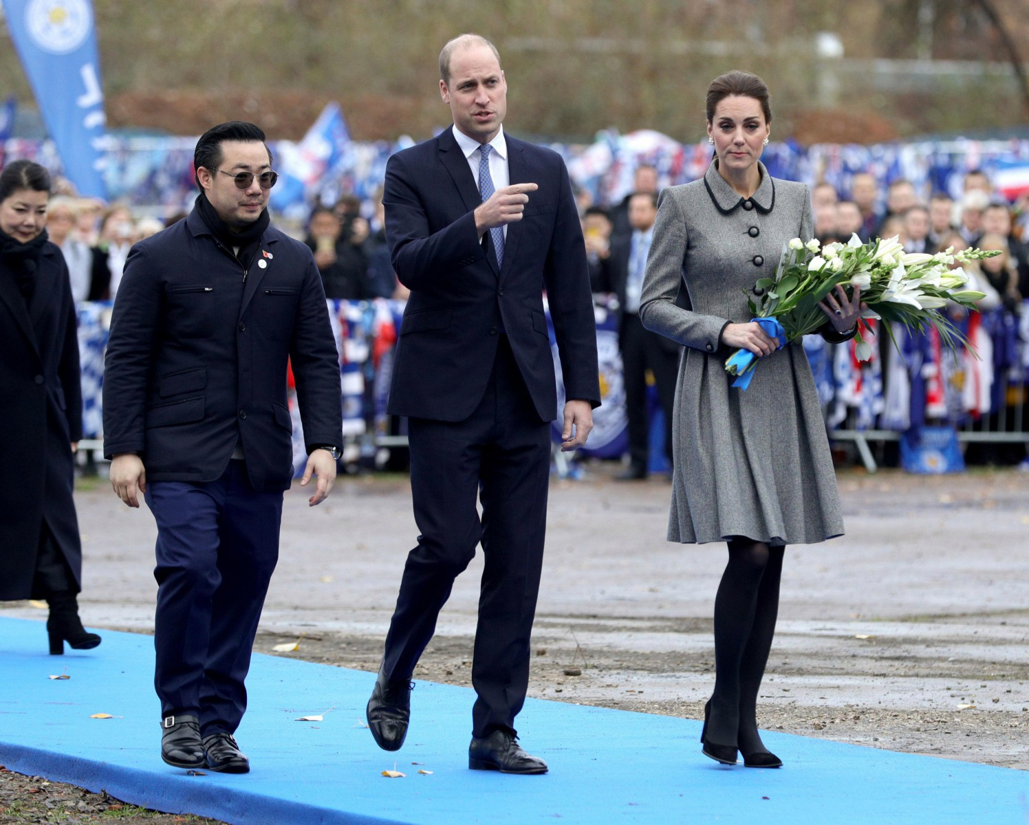 Kate Middleton carried flowers to lay among the thousands of tributes