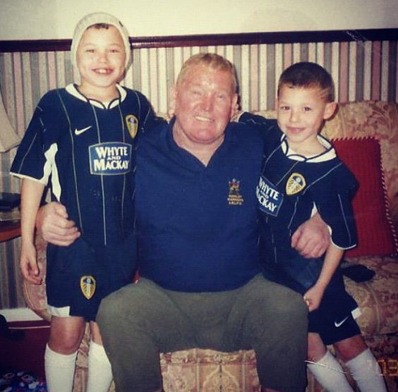 Phillips, pictured with his late grandfather, grew up Leeds mad in Armley, near Elland Road