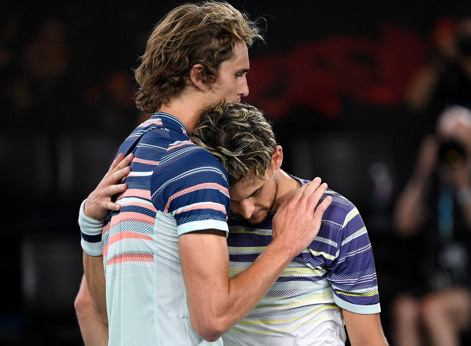 Good friends Thiem and Zverev embrace at the net following the end of the match