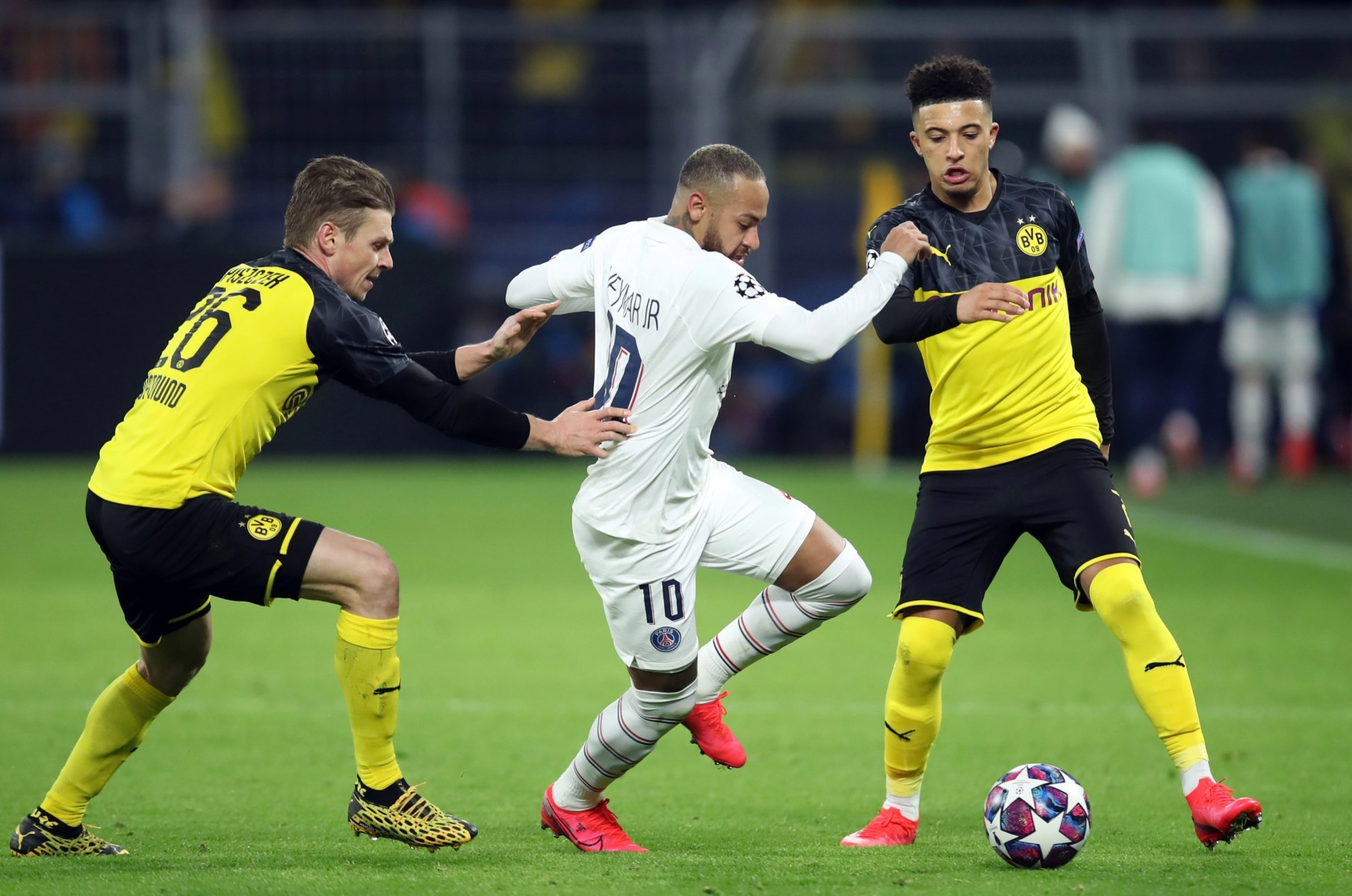Sancho and Neymar battle for possession during the 2-1 first-leg win for Dortmund in Germany