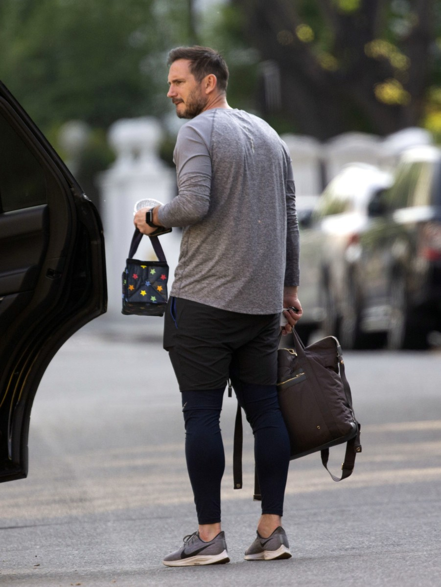 The Chelsea manager carried the bags as he enjoyed more family time away from the stresses of Premier League management