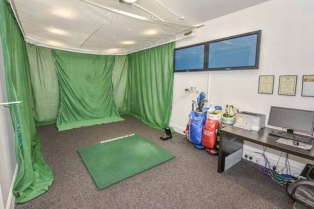 McIlroy's father Gerry converted the garage to be a golfing studio