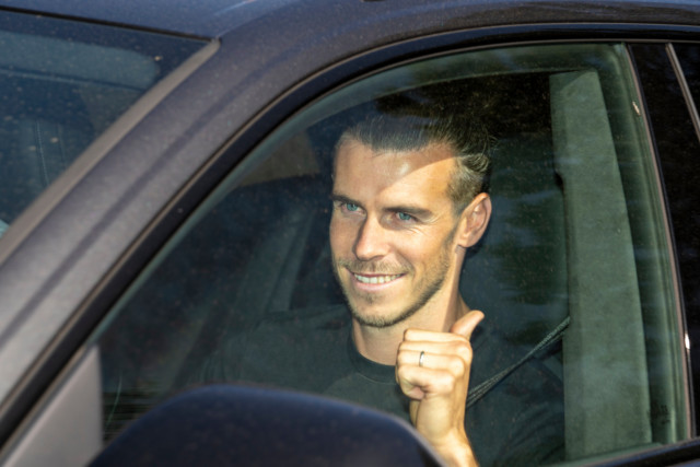 Bale gave the thumbs up as he arrived at Spurs' training ground