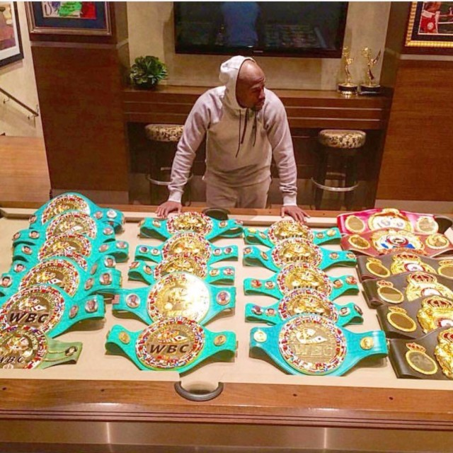 The undefeated champ showed off his amazing belt collection