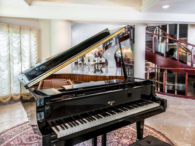 The reception room features a Weber grand piano