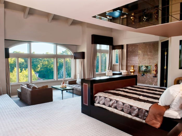 The master bedroom offers incredible views of the gardens