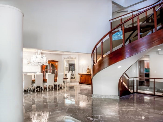 The ground floor features marble floors