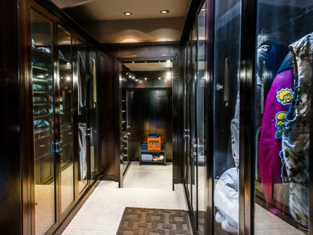 The walk-in closets are glass fronted