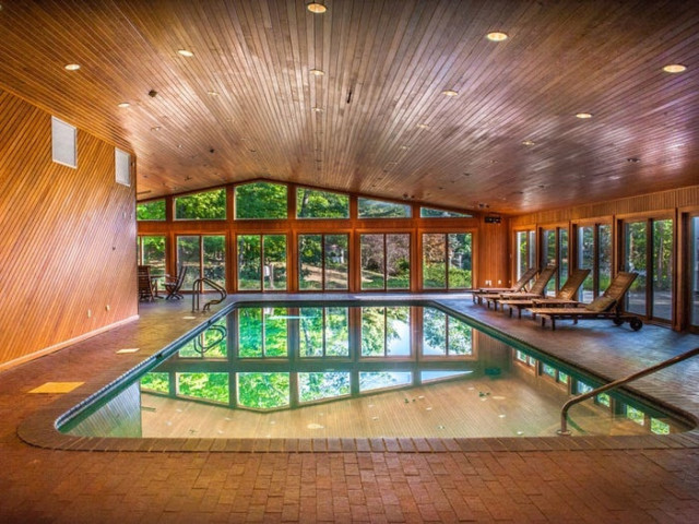 The indoor swimming pool is one of two at the home