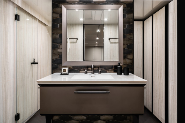 This bathroom is adjoined to the master suite