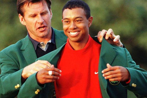 Tiger gets his first Green Jacket from Faldo in 1997