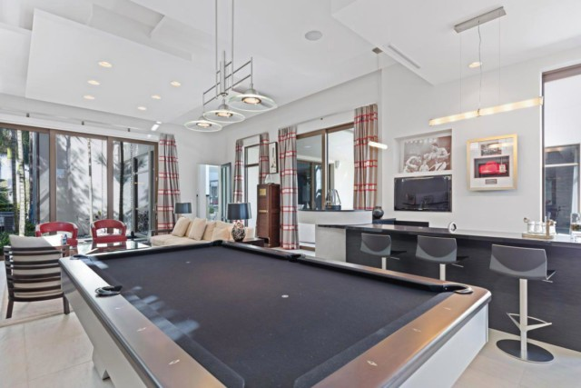 The £9.5m property had a games room with giant pool table that flowed out onto the patio